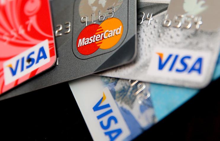 'Ведомости': Visa и Mastercard хотят ввести сервис перевода денег с карты на карту