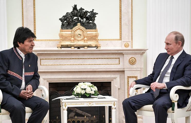 Путин и Моралес осудили неправомерное применение санкций